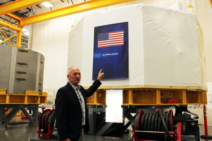 John Smith of General Atomics points to a module