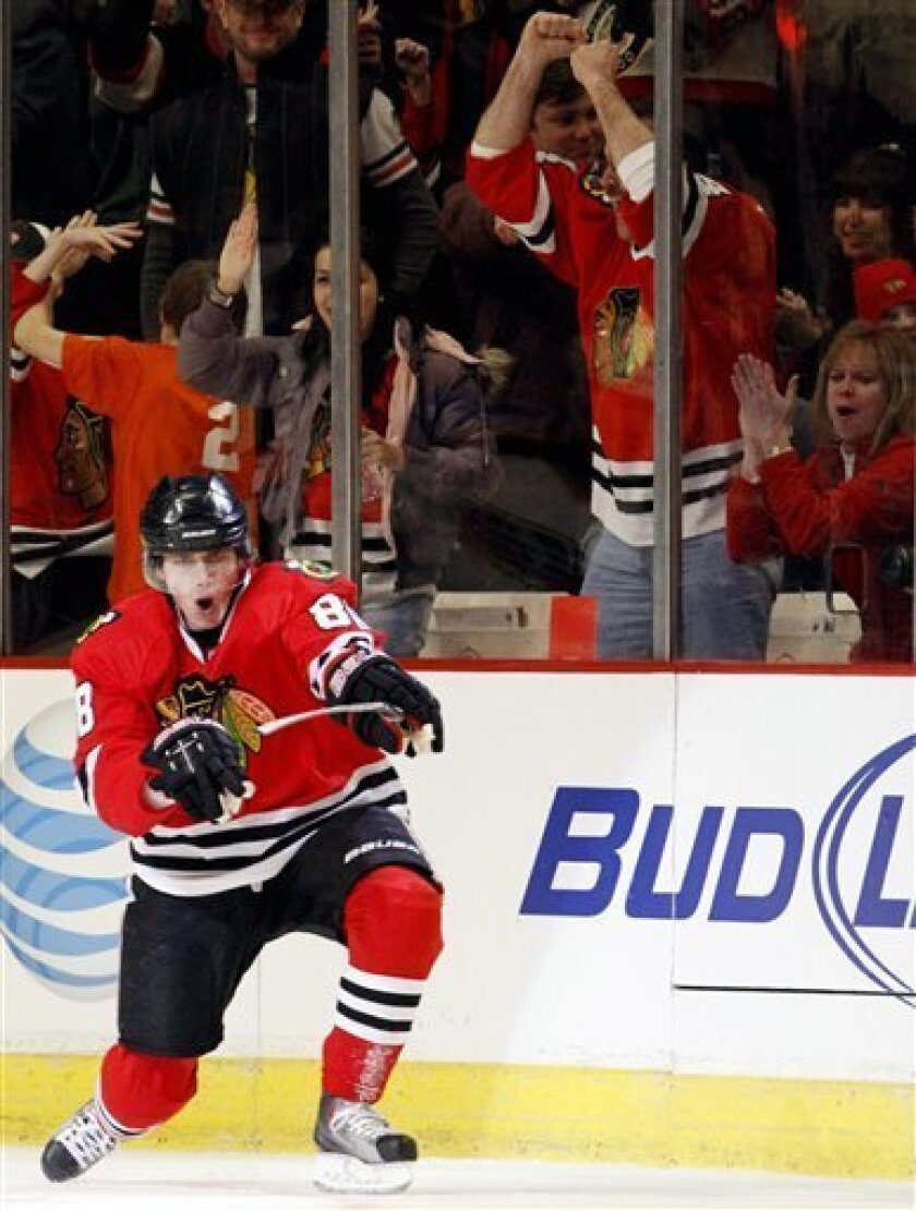 Chicago Blackhawks' Patrick Kane celebrates after scoring during the first period of an NHL hockey game against the St. Louis Blues in Chicago, Wednesday, Feb. 3, 2010. (AP Photo/Nam Y. Huh)