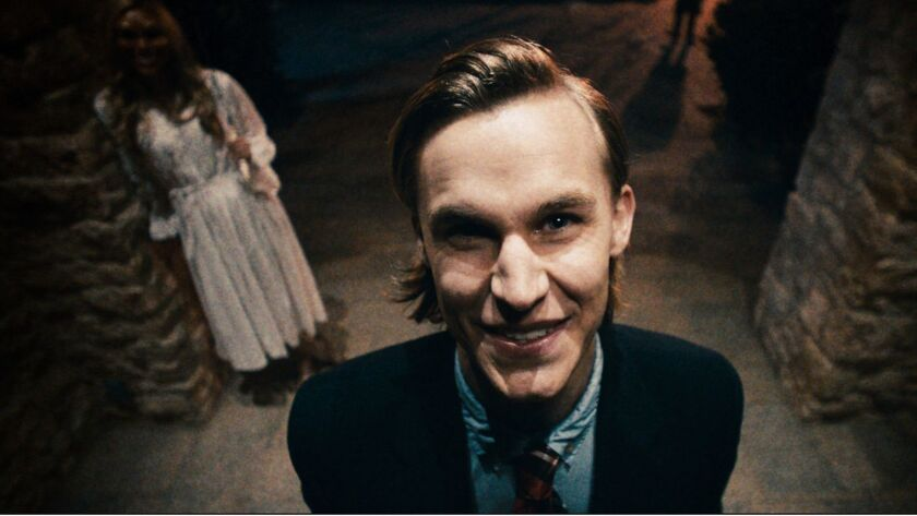 The leader (RHYS WAKEFIELD) of the celebrants terrorizes his prey in The Purge, a speculative thrill