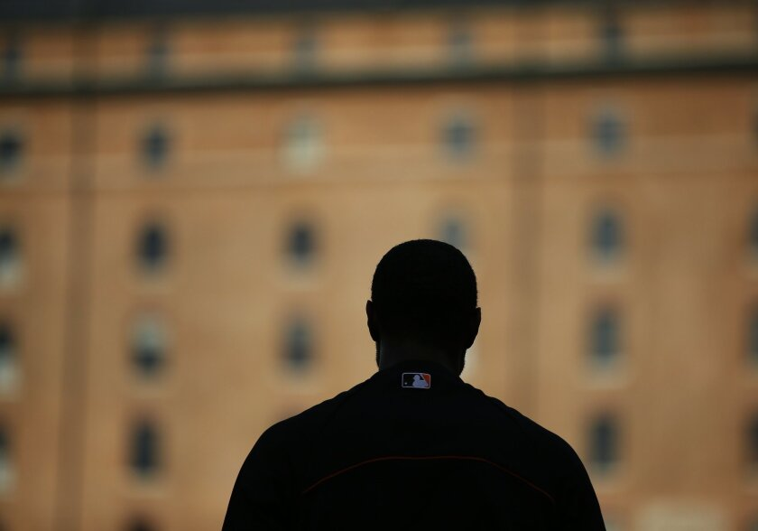 Baltimore Orioles center fielder Adam Jones waits to take batting practice before the American League baseball championship series Thursday, Oct. 9, 2014, in Baltimore. The Orioles will play Kansas City Royals starting Friday. (AP Photo/Matt Slocum )