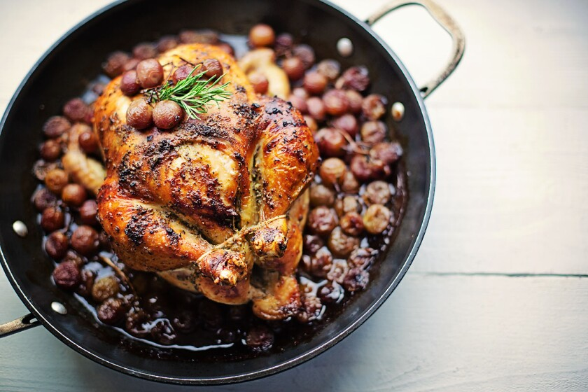 Rosemary Roasted Chicken with Red Grapes in a skillet.
