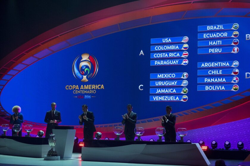 From left, Carlos Valderrama, Alexi Lalas, Mario Kempes and Jorge Campos, join Jurgen Mainka, center, master of ceremonies, Sunday, Feb. 21, 2016, at the completion of the official 2016 Copa Centenario Official Draw in New York. (AP Photo/Craig Ruttle)