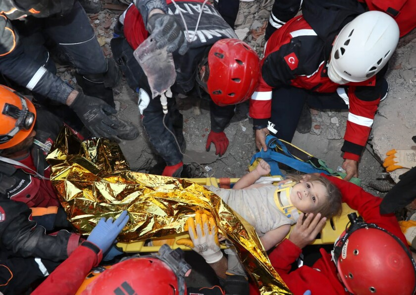 Rescue workers find Ayda Gezgin in the rubble of a collapsed apartment building in Izmir, Turkey.