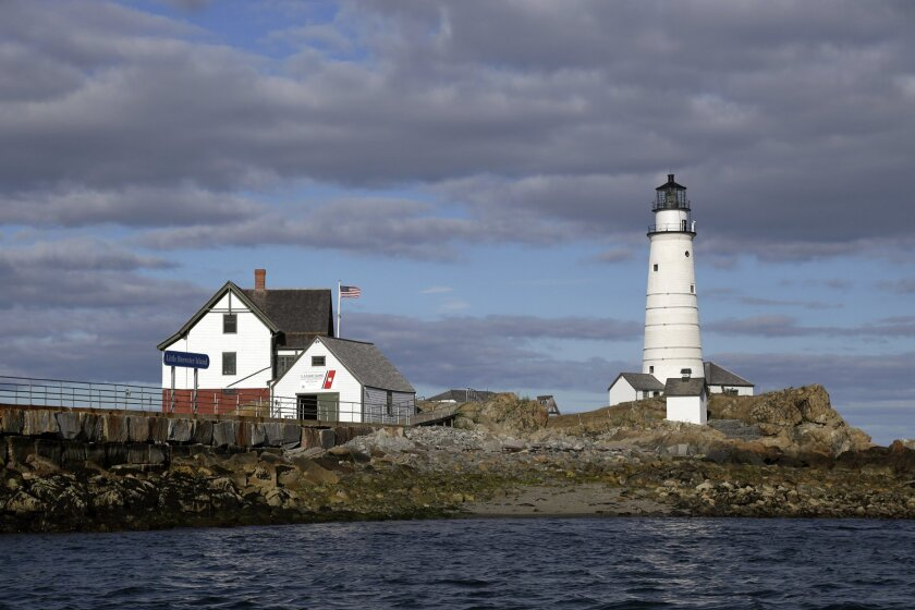 In this Aug. 17, 2016 photo, Boston Light, America's oldest lighthouse, sits on Little Brewster Island in Boston Harbor. The U.S. Coast Guard's last manned station will celebrate the 300th anniversary of its first lighting on September 14th. (AP Photo/Elise Amendola)