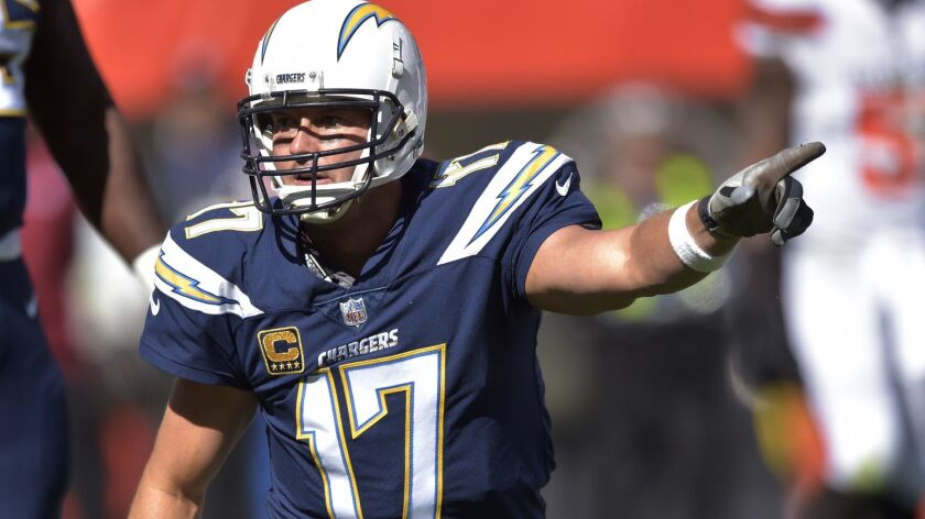 Los Angeles Chargers quarterback Philip Rivers points in the first half during an NFL football game
