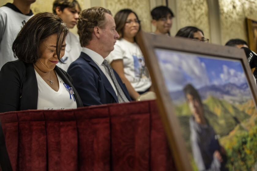 Juana Salcedo, guardian of Diego Stolz, weeps at a news conference