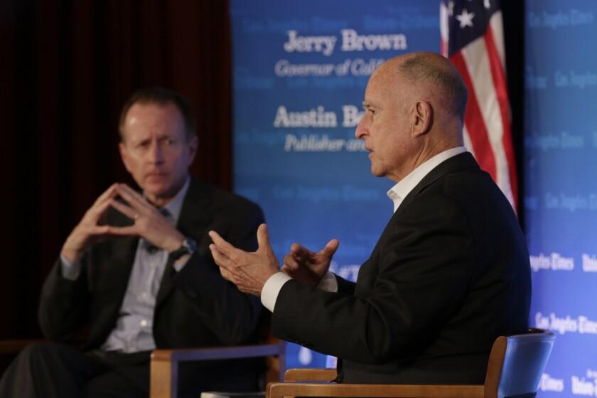 Times Publisher Austin Beutner, left, and Gov. Jerry Brown