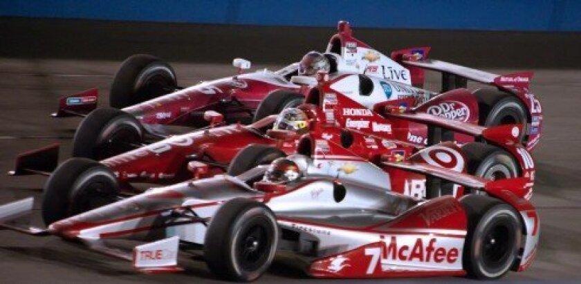 Sebastien Bourdais racing with Alex Tagliani and Marco Andretti