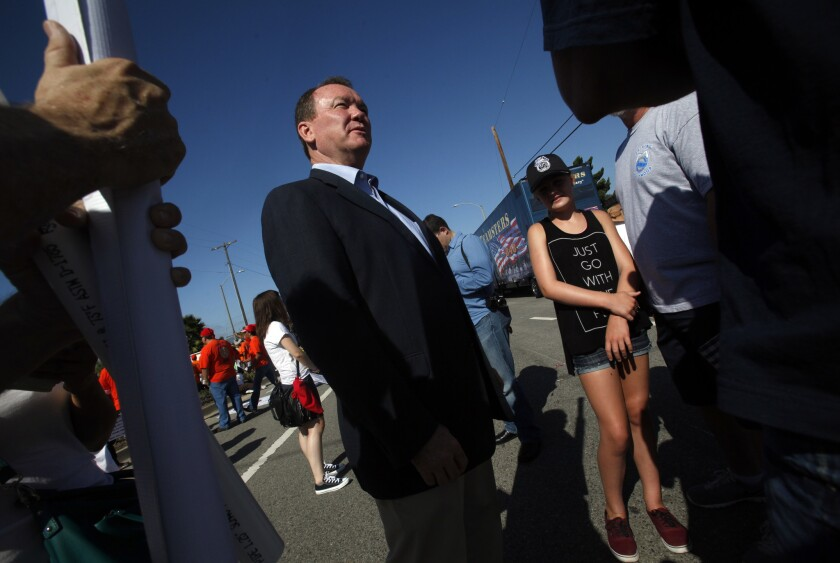 L.A. County Sheriff's candidate Jim McDonnell speaks with members of Hollywood 399 at the 35th annual Labor Day Parade in Wilmington.