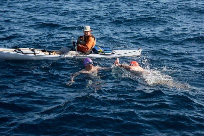 Steve Cross and Tony Joseph tag off in the relay swim.