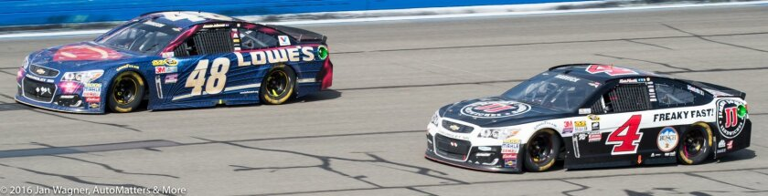 Jimmie Johnson passes Kevin Harvick on the backstretch for the win
