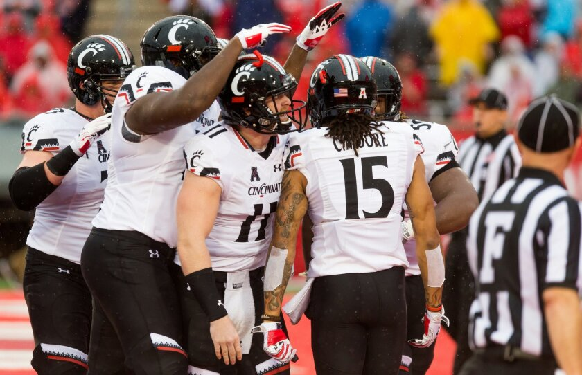 Cincinnati players celebrate in the end zone after scoring during the first half of an NCAA college football game against Houston at TDECU Stadium, Saturday, Nov. 7, 2015, in Houston. (AP Photo/Juan DeLeon)