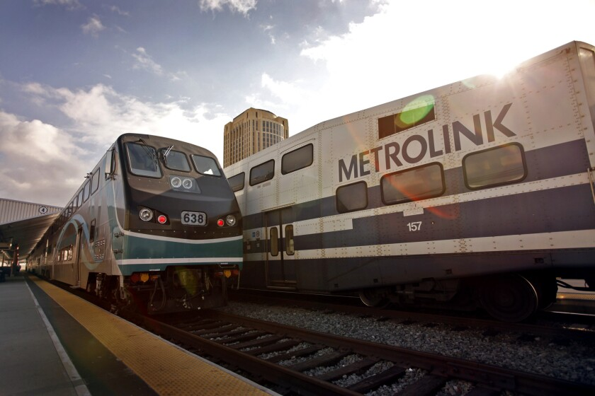 Two Metrolink trains wait for passengers recently at Union Station in downtown Los Angeles.