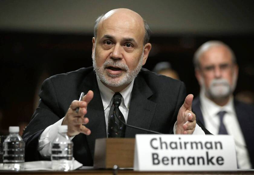 Fed's mixed messages roil markets
