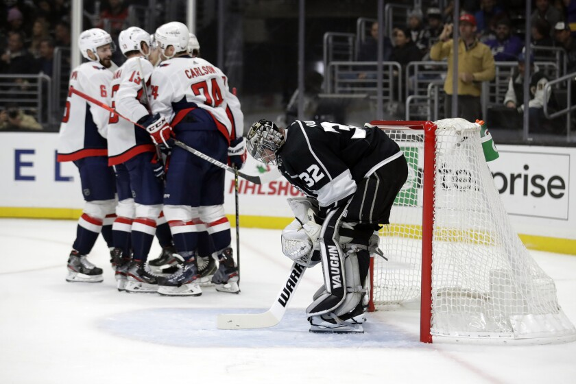 Kings goaltender Jonathan Quick looks down after giving up a goal to Capitals defenseman John Carlson (74) during the first period of a game Dec. 4 at Staples Center.