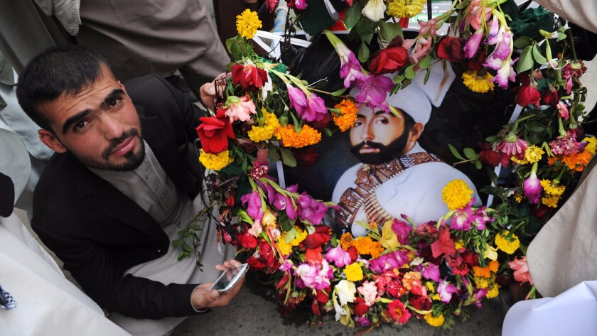 A supporter of former Afghan King Habibullah Kalakani during a re-burial ceremony in Kabul, Afghanistan, on Sept. 1, 2016.