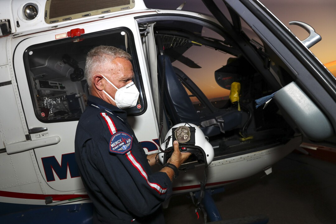 Mercy Air helicopter ambulance pilot Michael Bobeck prepares for a flight at Imperial County Airport.