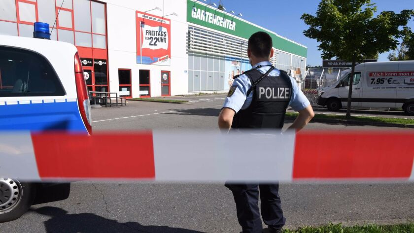 A policeman keeps watch near the disco Club Grey after the fatal shooting Sunday in the southern German town of Konstanz.