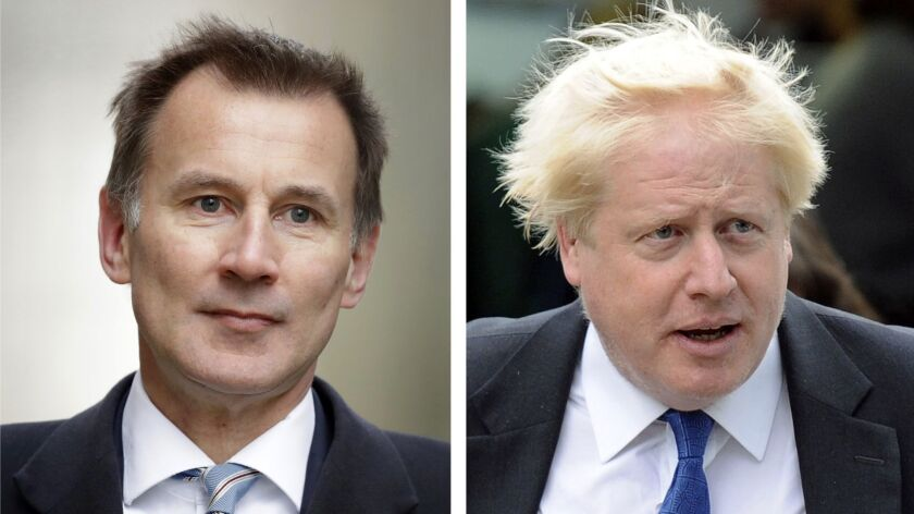 FILE - In this two photo file combo image, Jeremy Hunt, left, and Boris Johnson, right, who are the