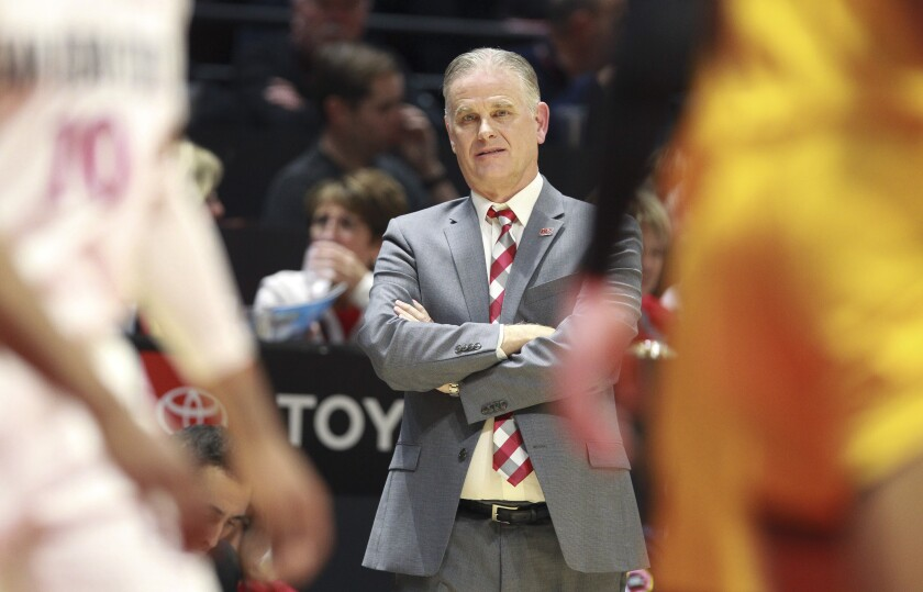 SDSU coach Brian Dutcher, shown here against Wyoming on Jan. 21, was named national coach of the year by USA Today.