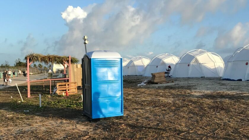 Tents and a portable toilet set up for attendees for the Fyre Festival on April 28, 2017 in the Exuma islands, Bahamas. Organizers of the music festival canceled the weekend event at the last minute after many had arrived and spent thousands of dollars on tickets and travel.