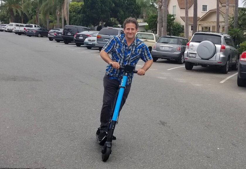 La Jolla Light reporter Corey Levitan samples dockless scooting on July 17.