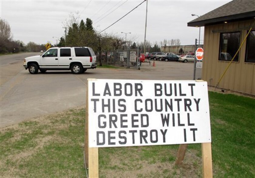 A pro-labor sign is posted outside the entrance of the American Crystal Sugar Co. plant in Moorhead, Minn., Monday, April 2, 2012. About 1,300 employees in North Dakota, Minnesota and Iowa have been locked out since Aug. 1, after union workers rejected a company contract offer. Union protesters no longer take turns picketing, as was the case in the first several months of the lockout. (AP Photo/Dave Kolpack)