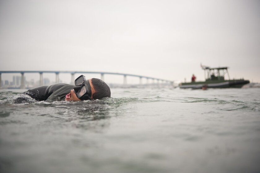 San Diego County is no stranger to the special operations boom. The Naval Special Warfare command is in Coronado with SEAL Teams 1, 3 and 5. A battalion of Marine Corps Raiders resides at Camp Pendleton. Here, with the Coronado bridge in the distance, a SEAL candidate swims in San Diego Bay as part of Basic Underwater Demolition/SEAL training.