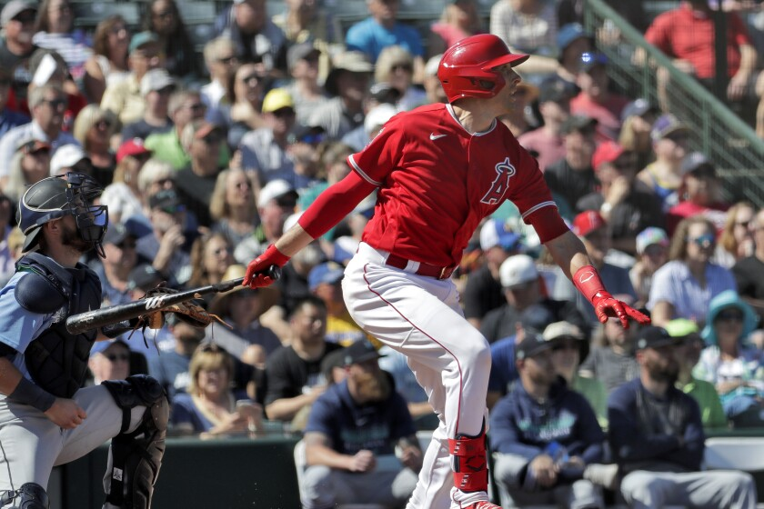 Angels' Jason Castro follows through on an RBI base hit during the second inning of a spring training game against the Seattle Mariners on Wednesday in Tempe, Ariz.