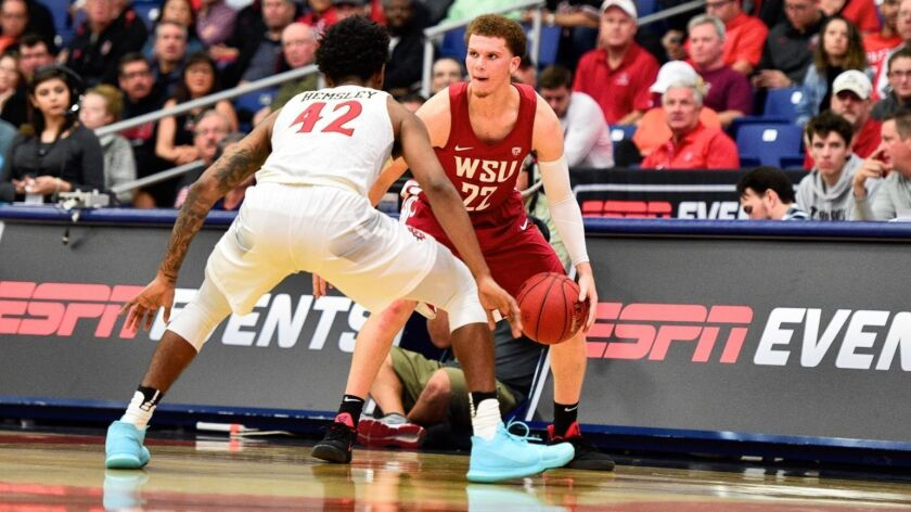 Malachi Flynn, shown here playing for Washington State against SDSU's Jeremy Hemsley last year, had 27 points in an intrasquad scrimmage.