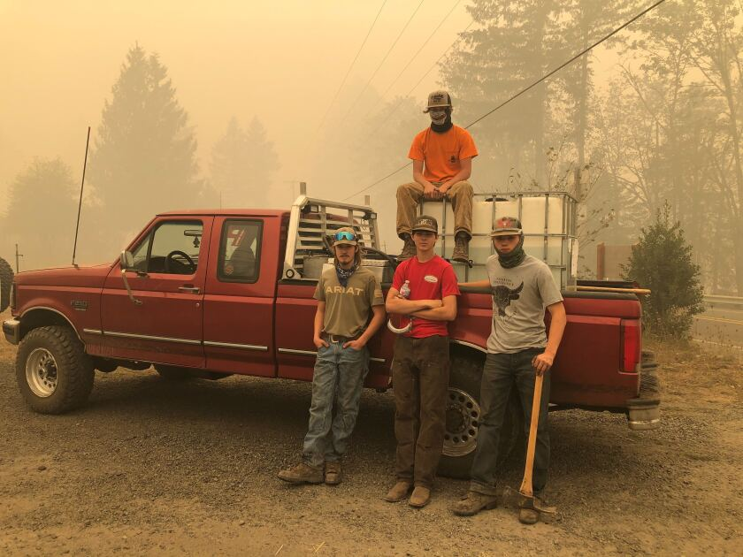 Jon Pennick, 16, joins some friends to fight fires in Gates, east of Salem, Ore.