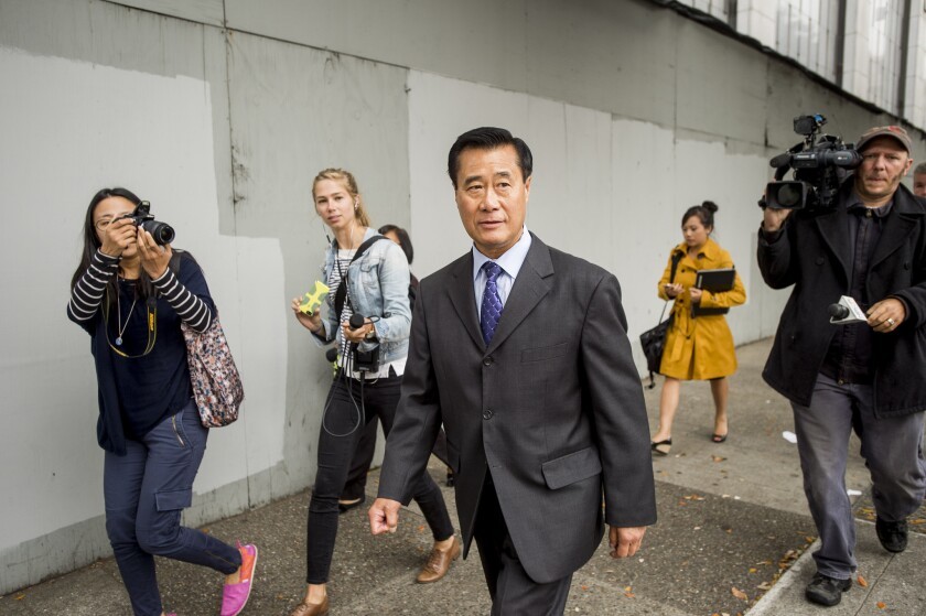 California state Sen. Leland Yee leaves federal court in San Francisco Thursday after he pleaded not guilty to charges including racketeering.