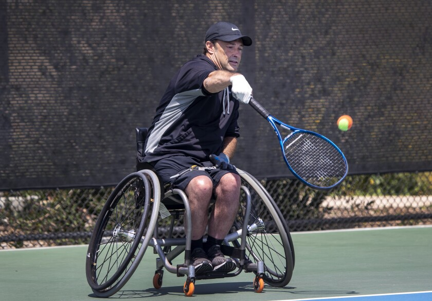 Paralympian David Wagner serves during a U.S. Tennis Assn. event for youth players at Great Park in Irvine.