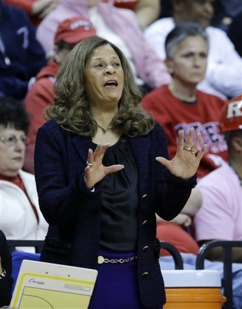 Rutgers head coach C. Vivian Stringer shouts to her players during the first half of an NCAA college basketball game against Connecticut Saturday, Feb. 16, 2013, in Piscataway, N.J. Connecticut won 65-45. (AP Photo/Mel Evans)