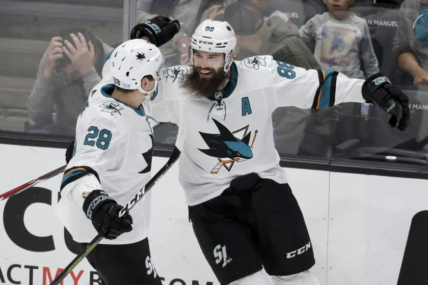 Sharks defenseman Brent Burns celebrates a goal with Timo Meier during the third period of a game Nov. 14 against the Ducks at Honda Center.