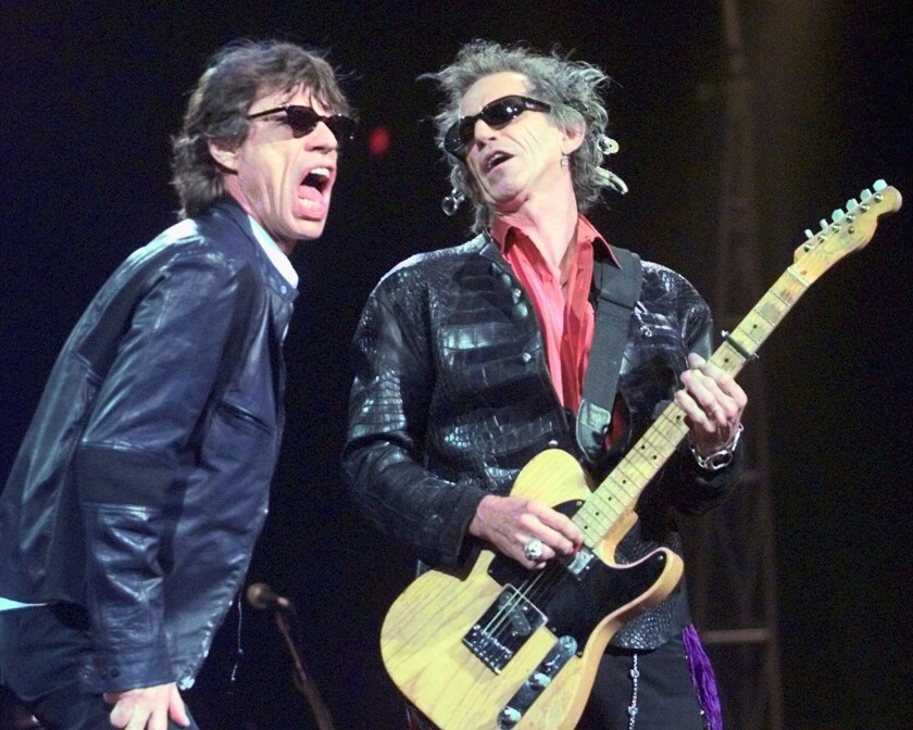 Mick Jagger and Keith Richards perform during a Rolling Stones' tour stop in 1999.