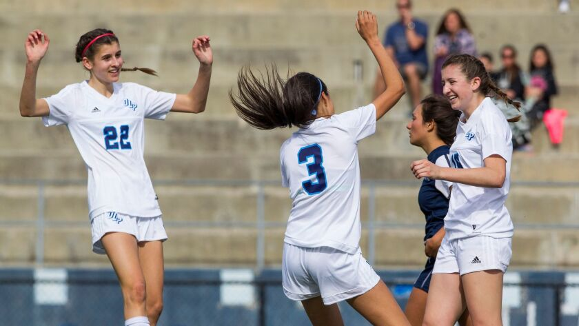 OLP's (left to right) Erin Healy (22), Liliana Morales (3), and Ashlin Healy (15) celebrate a second-half goal.