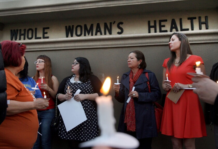 People held a candle light vigil in front of the Whole Women's HealthClinic in McAllen, Texas in March, above. The clinic is reopening after a federal judge blocked part of a sweeping new law restricting abortions.