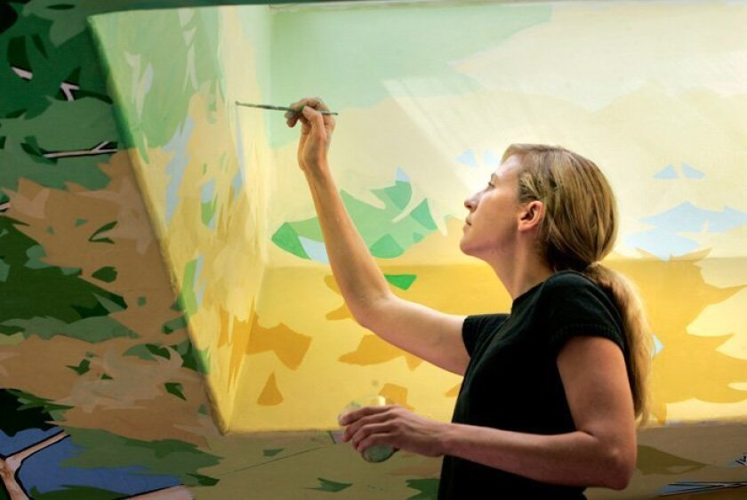 Visiting muralist Beth Clevenstine is finishing up a ceiling mural that will wrap around the new circular interpretive center at the Elfin Forest Recreational Reserve. (CHARLIE NEUMAN / Union-Tribune)