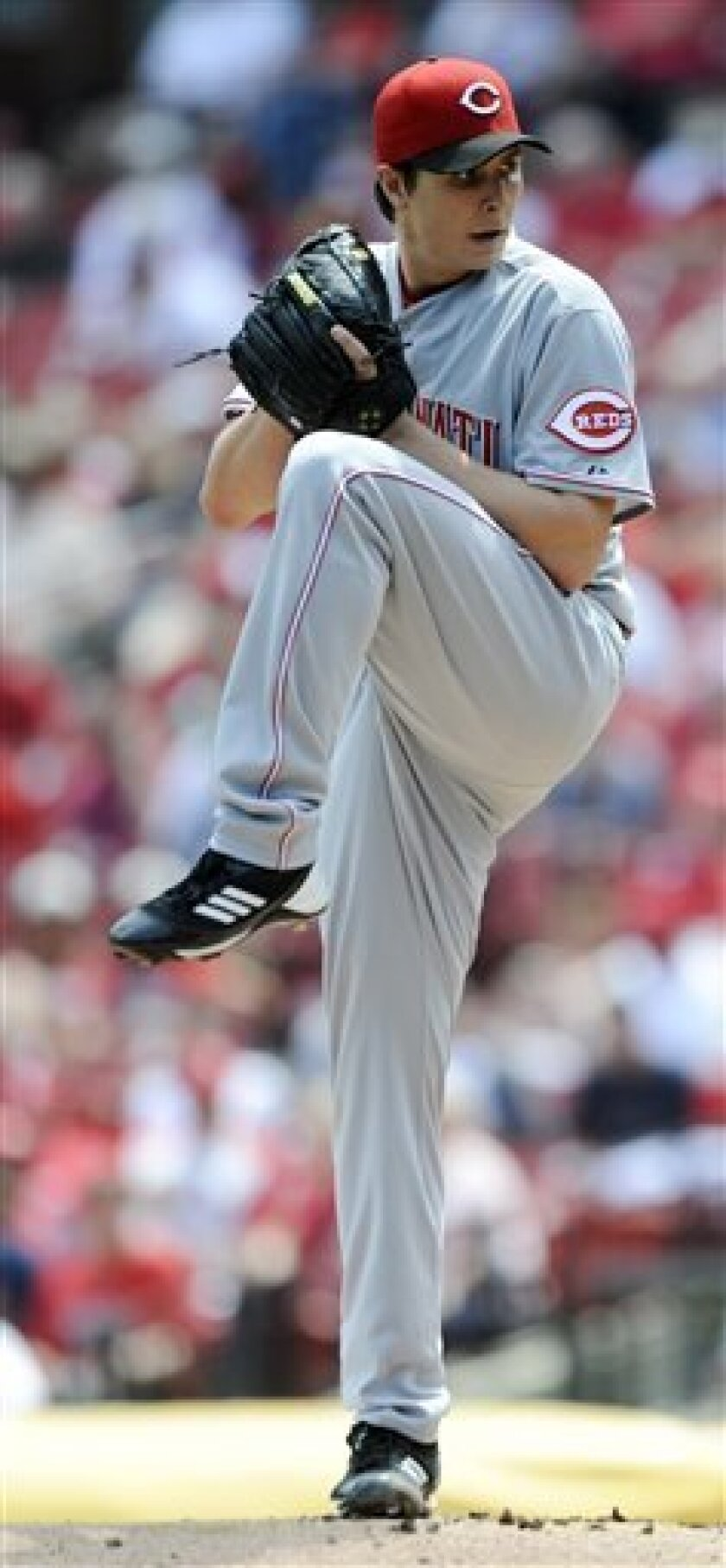 Cincinnati Reds starting pitcher Homer Bailey winds up to throw against the St. Louis Cardinals in the first inning in a baseball game Wednesday, May 1, 2013, at Busch Stadium in St. Louis. (AP Photo/Bill Boyce)