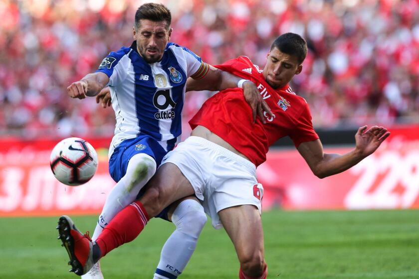 Benfica`s Ruben Dias (R) fights for the ball with Hector Herrera of FC Porto during their Portuguese First League soccer match held at Luz stadium, Lisbon, Portugal, 7th October 2018.
