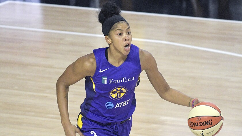 Candace Parker had 16 points, 12 rebounds and four assists to help the Sparks beat the Phoenix Mercury on Wednesday.