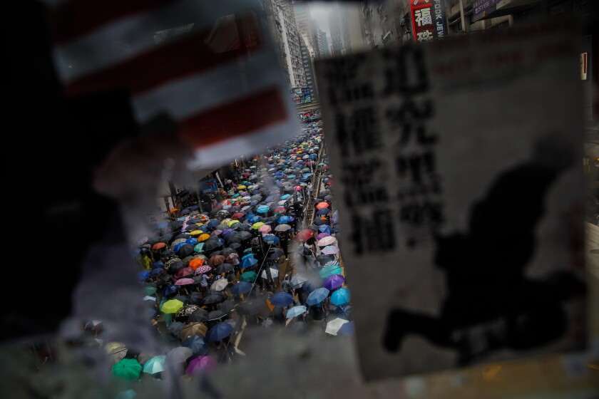 Thousands protest as bid to block Hong Kong mask ban fails