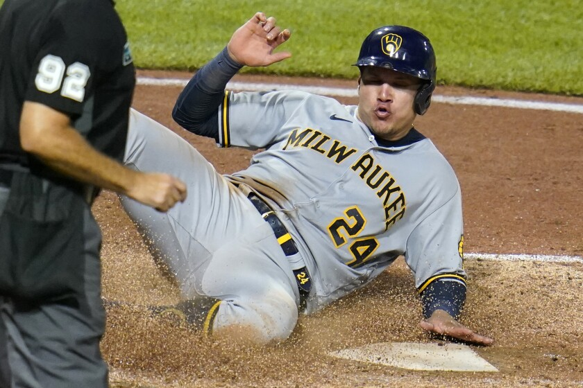 Milwaukee Brewers' Avisail Garcia scores on a single by Tyrone Taylor off Pittsburgh Pirates relief pitcher Chasen Shreve during the seventh inning of a baseball game in Pittsburgh, Wednesday, July 28, 2021. (AP Photo/Gene J. Puskar)