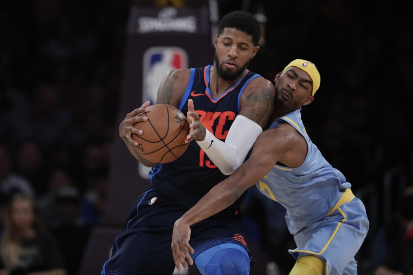 Lakers forward Corey Brewer tries to defend against Thunder forward Paul George during first half action.