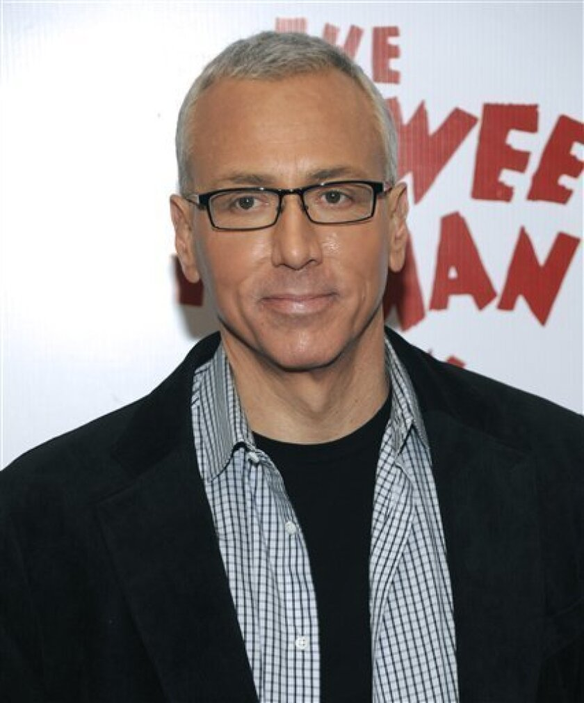 In this Wednesday, Jan. 20, 2010 photo, Dr. Drew Pinksy arrives at the opening night of The Pee-Wee Herman Show in Los Angeles, Calif. A Los Angeles man accused of stalking Dr. Drew Pinsky and threatening the reality television and radio personality and his family has pleaded not guilty to six felony counts. (AP Photo/Dan Steinberg)