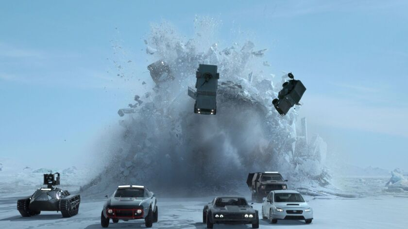 """'Furious' family members in fast cars take on a nuclear submarine in """"The Fate of the Furious."""" Cred"""