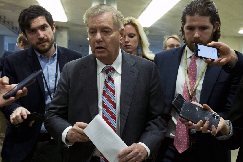 Sen. Lindsey Graham (R-S.C.) speaks to reporters as he walks to the Senate chamber for the impeachment trial