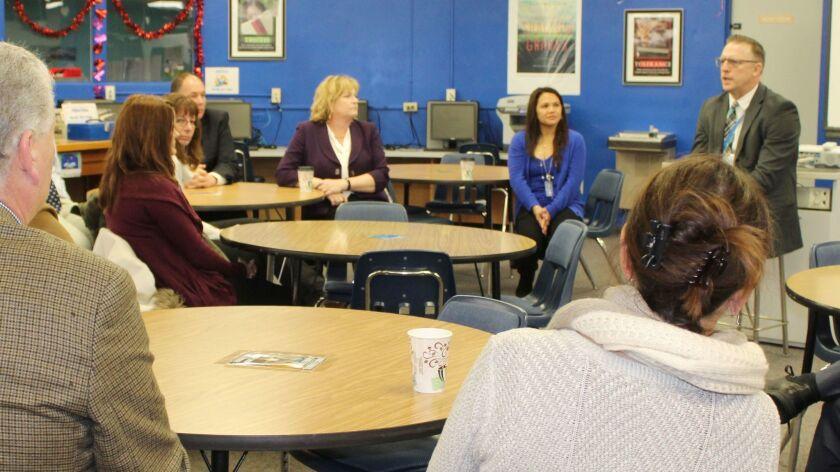 Mira Costa High School Principal Ben Dale, right, talks to school administrators, teachers, school trustees, and community members in Ramona High School Library.