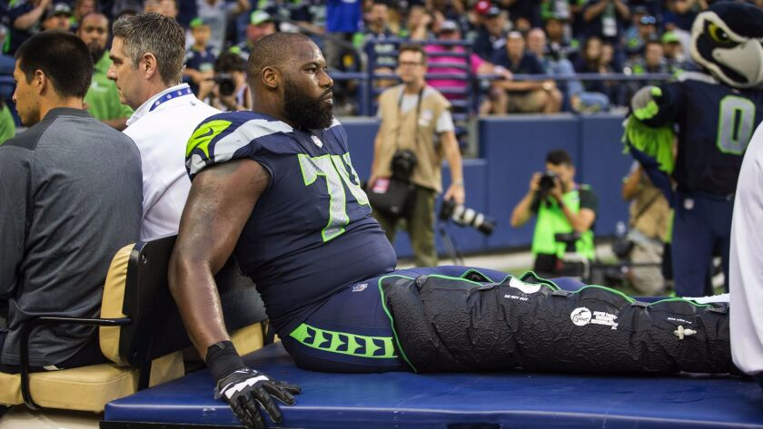 Seattle Seahawks left tackle George Fant is carted off the field with a knee injury in the second quarter against the Minnesota Vikings on Friday.
